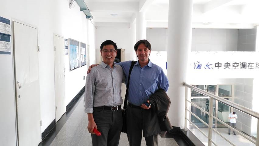 Hora, at Qingdao Technical College on China's north coast, with Lu Xiaoze, assistant dean of engineering.